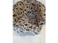 Lovely comfortable tub chair .brown and cream pattern.smoke and pet free home .50 pound or nearest