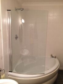 White corner bath including glass shower screen including waste. Excludes taps.