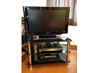 tv, tv stand, dvd player, sky box