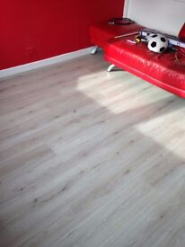 Oak 7mm Laminate flooring supplied and fitted with underlay and beading 20m2 £295