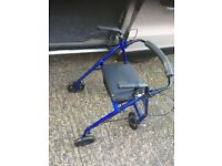 Mobility walking aid with seat