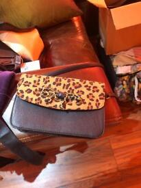 Black and leopard print cross body bag