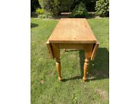 Vintage style antique pine drop leaf table.
