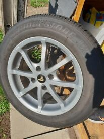 4 Glittery Alloys for sale 185/65r15 with brand new bridgestone tyres