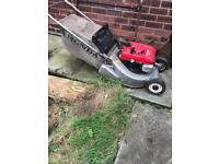 For sale is an honda 1950 lawn mower