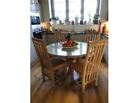 Round Oak Dining table and 4 oak chairs