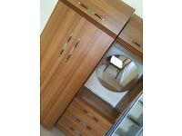 Wardrobe unit with cupboards, drawers & mirror
