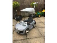 Kids ride on Audi with sun roof