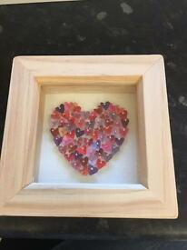 Picture frame with pinned hearts
