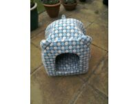 Blue and white igloo type cat bed