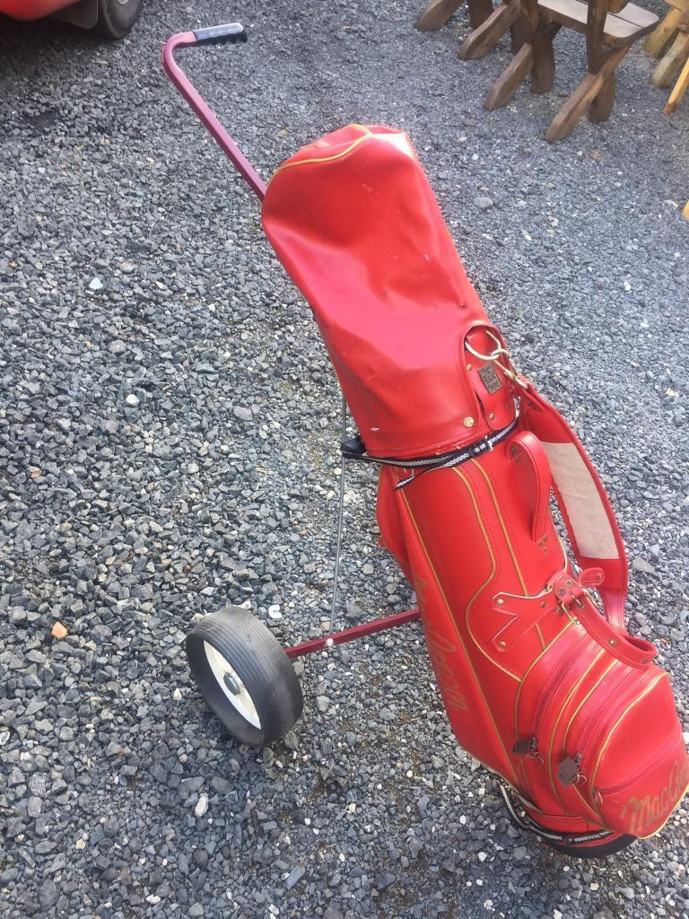 Golf trolley,clubs and balls