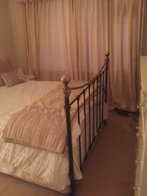 Decorative metal bed surround