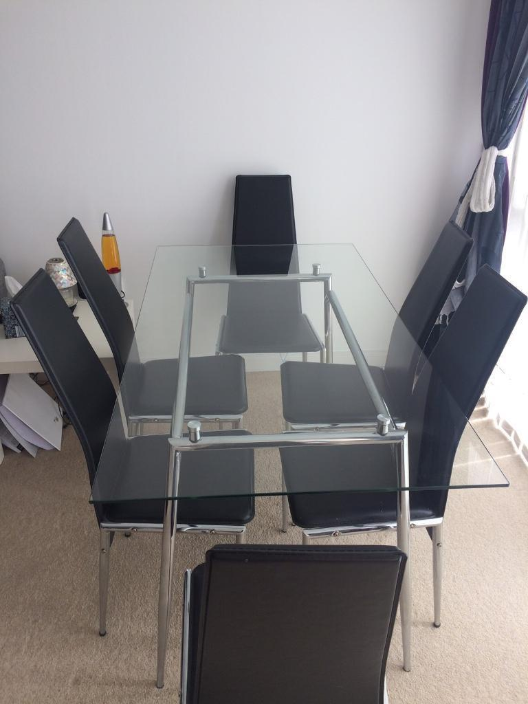 For Sale Glass Dining Table And Six Black Leather Chairs