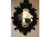 Large ornate designer mirror