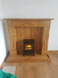 Large wooden fireplace with electric fire