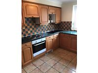 A spacious two bedroom part furnished flat in Woodseats with fitted kitchen and own single garage