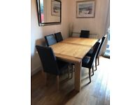 Solid oak dining table and 6 leather chairs from Marks and Spencer. Excellent condition