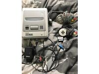 Nintendo Snes With 2 Controllers