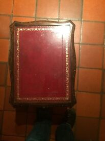 Red leather antique stool with glass top