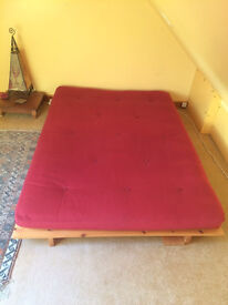 Luxury 'ultra' double futon/sofa bed with classic wooden slatted base. Washable burgundy cover.