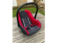 RED AND BLACK BABY CAR SEAT AND CARRIER. USED BUT IN GOOD CONDITION.