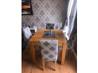 Solid Oak dining table and matching mirror