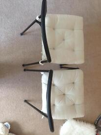 2 Ikea black plastic chairs with 4cushions