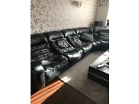 DFS black leather sofa. Total nine chairs,click to each other. Four with arms.Collection only