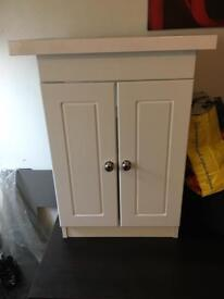 Floor standing white bathroom storage cabinet with marble top