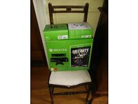 XBox One 500GB with two controllers and two special edition games