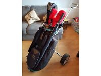 Full set of Cleveland golf clubs, woods, putter, bag and extras