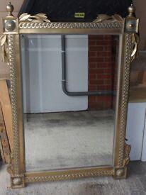 Large ornate gold leaf framed mirror