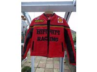 Red Ferrari motorcycle type leather jacket excellent condition for age approximately 12-14 years