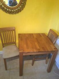 Solid oak table with two chairs