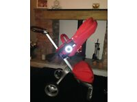 Stokke Xplory Red pram with Carry cot attachment, shopping bag and rain cover