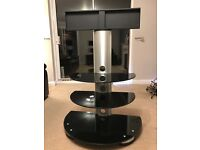 TV mount / stand with 3 black glass shelves. Cables hidden in centre pillar out of site.