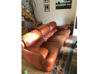 Well used leather sofa.
