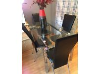 Ex Display / Showhome Glass Table And Four Chairs. Good Quality with very nice chrome legs