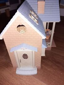Sylvanian Families house with furniture, rabbit family and swing set