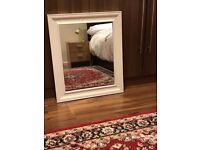 Mirror with a white frame