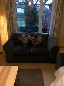 Only 2 months old!!!! 2 seater grey fabric sofa