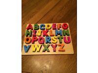 Wooden alphabet shape sorter