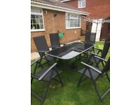Garden table and 6 reclining chairs