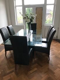 Large Glass dining table and 6 leather chairs