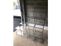Shelving unit with glass shelves