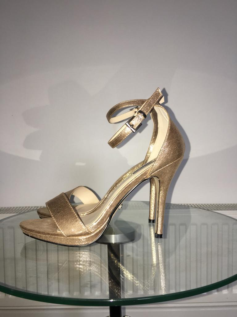 Gold heels size 8 (fits 7) still in box