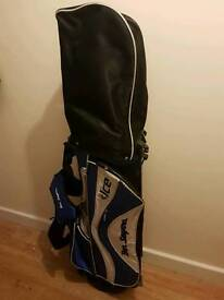 Golf bag and couple of clubs