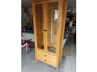 Tall oak display cabinet