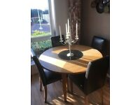 Light oak round table with glass centre and 4 leather dinning chairs