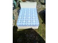 Double bed divan part sprung folding base with checked mattress and headboard